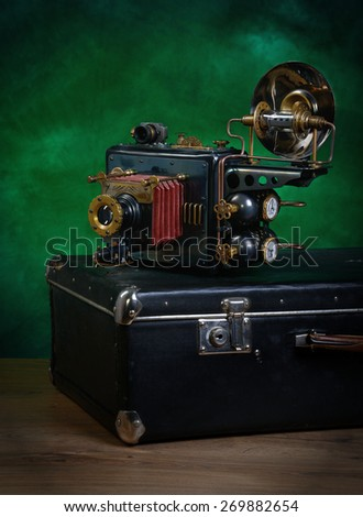 photo camera steampunk on a green background.   - stock photo