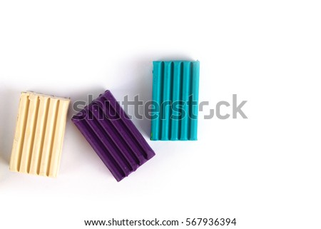 Photo children's colored plasticine isolated on white background. Materials for creativity.