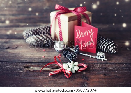 Photo: Christmas present on dark wooden background / selective focus - stock photo