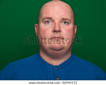 photo close-up of an overweight male, on green - stock photo