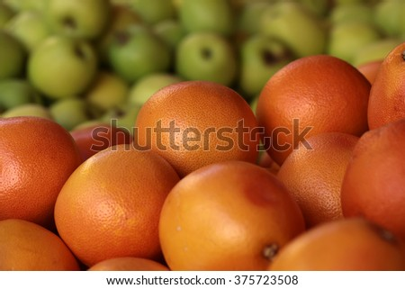 Photo closeup many clean organic natural fresh tasty ripe grape-fruits and green apples crop fruit full of vitamin for healthy eating diet ball form for sale on blurred background, horizontal picture - stock photo
