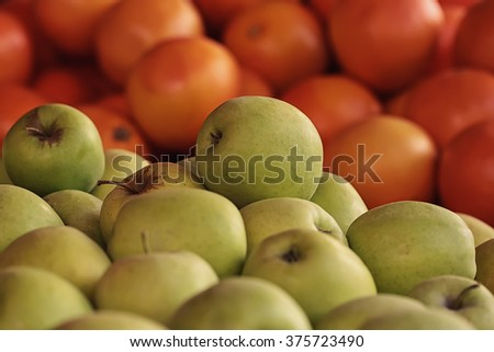 Photo closeup many clean organic natural fresh tasty ripe yellow apples and grape-fruits crop fruit full of vitamin for healthy eating diet ball form for sale on blurred background, horizontal picture - stock photo
