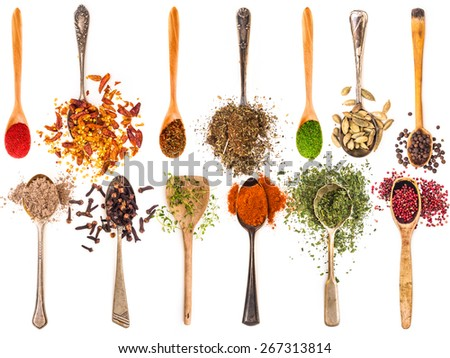 photo collage of metal and wooden spoons with spices on a white background - stock photo