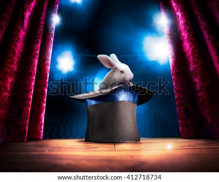 photo composite of a bunny in a magic hat on a stage - stock photo