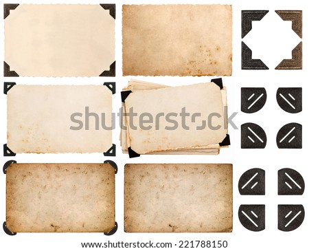 photo corner, old photo card, aged paper isolated on white background - stock photo