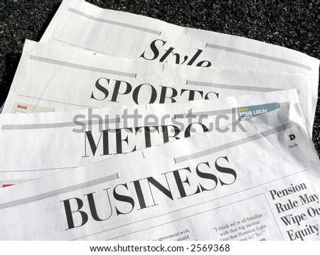 photo displaying newspaper sections