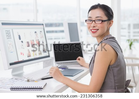 Photo editor working at her desk in creative office