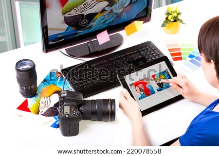 Photo editor working on computer and used graphics tablet. - stock photo