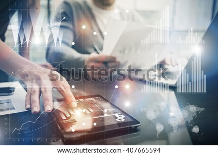 Photo female hands touching screen modern tablet. Account managers working new investment project in office. Using electronic devices. Graphics icons, worldwide stock exchanges interface. Horizontal - stock photo