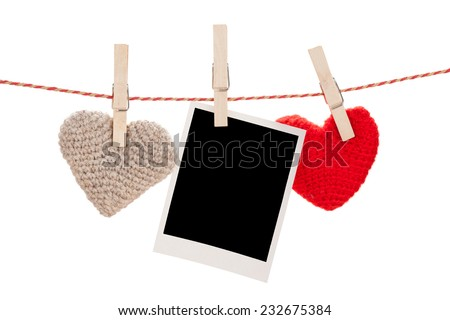 Photo frame and valentines day toy hearts hanging on rope. Isolated on white background - stock photo