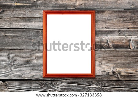 Photo frame hanging on wooden wall - stock photo