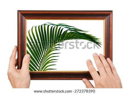 Photo Frame in the hands isolated on white background - stock photo