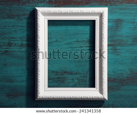 Photo frame on color wooden background - stock photo