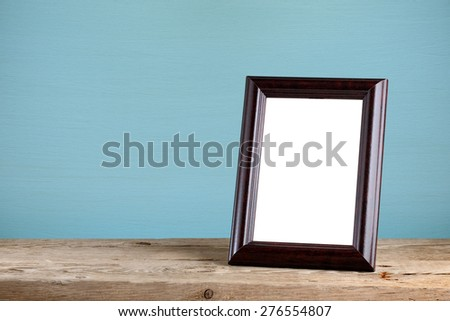 Photo frame on old wooden table