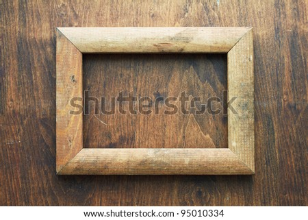 photo frame on old wooden wall - stock photo