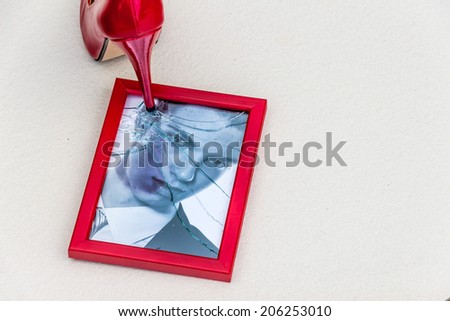 photo frames and high heels. symbolic photo for divorce, separation and relationship crisis - stock photo