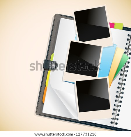 photo frames and notepad sheets on open diary - stock photo