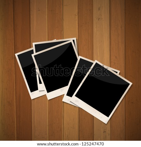 Photo frames on wooden background.Raster version - stock photo