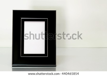 photo frames on wooden table