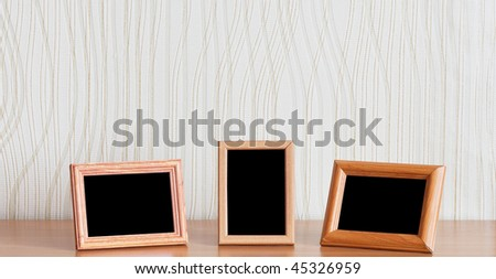 photo frames on wooden table - stock photo