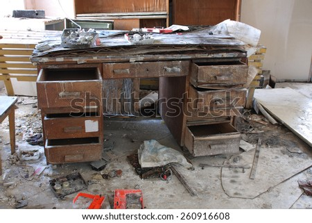 Photo from demolition  textile  factory,broken table. - stock photo