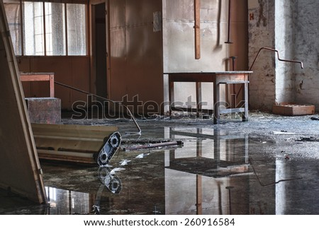 Photo from demolition  textile  factory, hall with water reflection. - stock photo