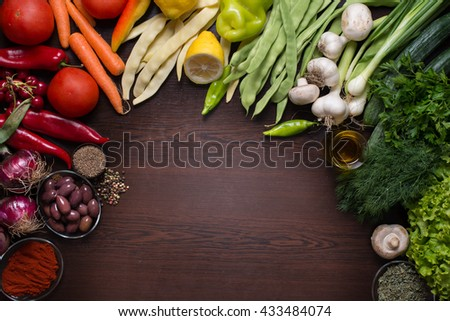Photo from directly above of variation of different autumn vegetables and spices around and space for a text in the center  - stock photo