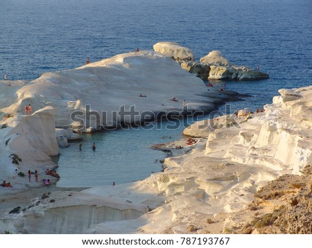 Photo from famous white volcanic rock formations - caves in Sarakiniko beach, Milos island, Cyclades, Greece