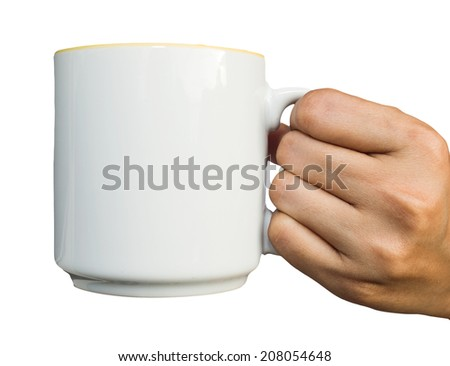 Photo hand holding white blank empty mug for coffee or tea isolated on white background. - stock photo