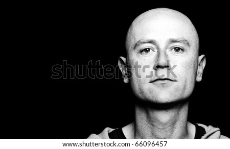 photo high contrast dark moody capture of a midde age male on black screen