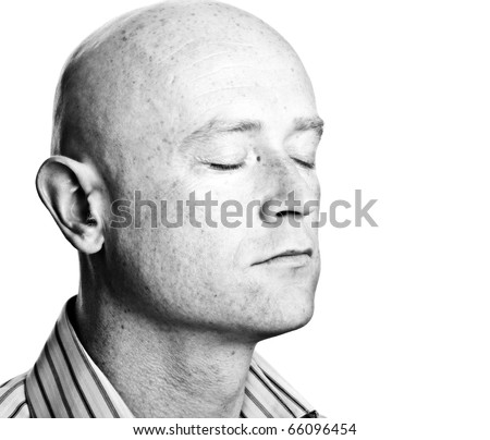 photo high contrast dark moody close up male shaved bald head - stock photo