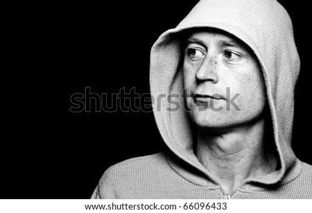 photo high contrast dark moody male in a hoodie funky clothes on black