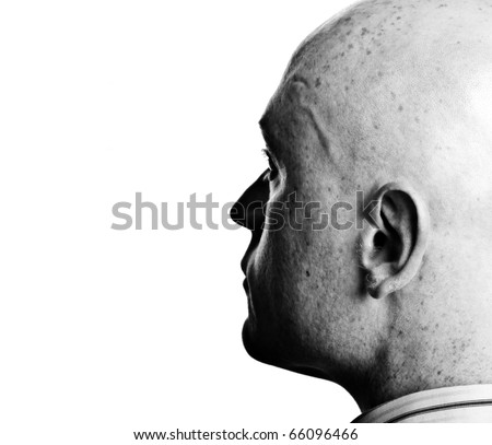photo high contrast dark moody male portrait close up on white backdrop - stock photo
