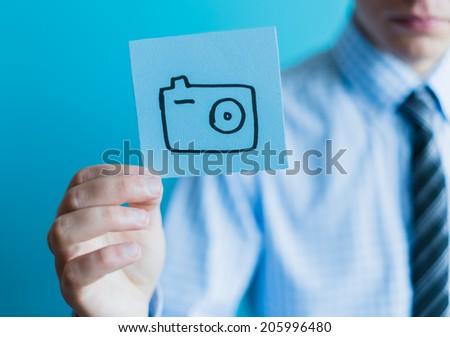 photo icon in  hand - stock photo