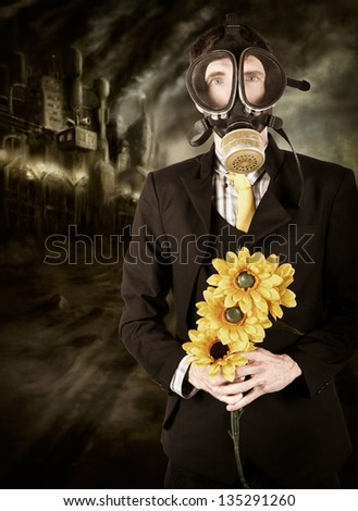 Photo illustration of a businessman wearing gas mask standing in industrial wasteland of smog and pollution holding sunflowers in a depiction of the carbon tax on climate change - stock photo