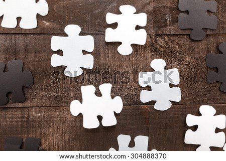 Photo illustration showing the business concept of engineering applied to industries or internet with puzzle pieces
