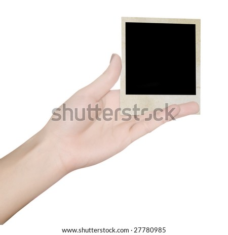 photo in a hand over white