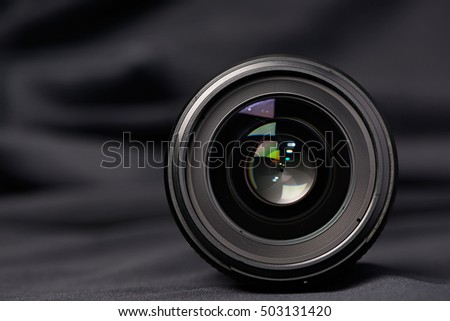 Photo lens front view on blurred background