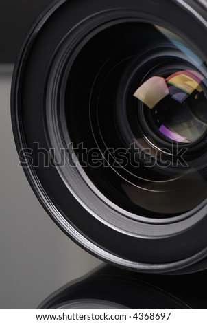 Photo lens with lens reflections. - stock photo