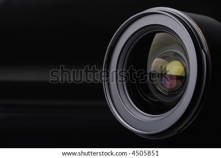 Photo lens with reflections on black background