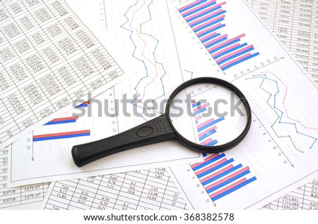 Photo magnifier with graphs and figures in the tables