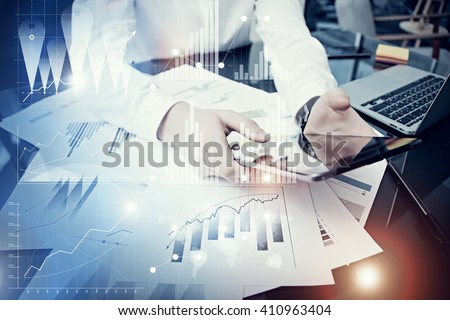 Photo man holding modern tablet screen.Trader manager working new private banking project office.Using electronic device.Graphics icon,worldwide stock exchanges interfaces.Horizontal.Bokeh,film effect