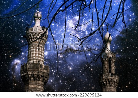 Photo-montage of Cairo minarets end infant stars in the small Magellanic Cloud (Elements of this image furnished by NASA) - stock photo