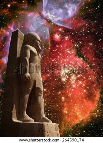 Photo-montage of Ramses II colossus and Small Magellanic Cloud and Butterfly Nebula (Elements of this image furnished by NASA) - stock photo