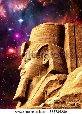Photo-montage of Ramses II statue in Abu Simbel and Small Magellanic Cloud as background (Elements of this image furnished by NASA) - stock photo