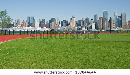 photo new york city cityscape over hudson river - stock photo