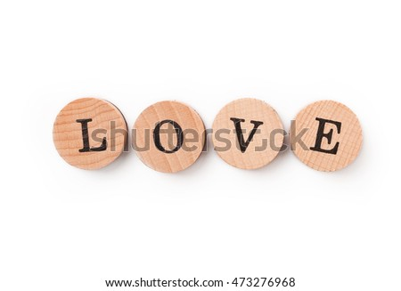photo of a alphabet blocks spelling LOVE isolate on white background