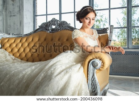 photo of a beautiful brunette bride in a luxurious wedding dress - stock photo