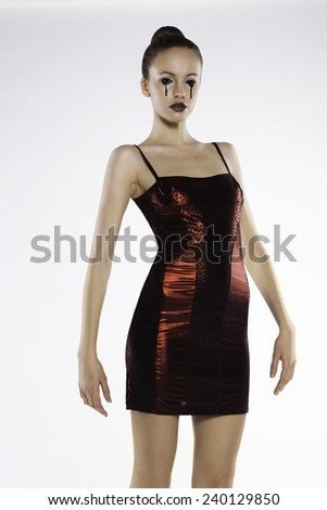 Photo of a beautiful girl in a red dress in the studio on a white background - stock photo
