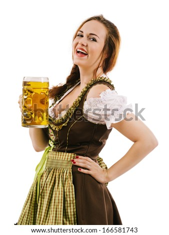 Photo of a beautiful happy woman wearing traditional dirndl, laughing and holding a huge beer.